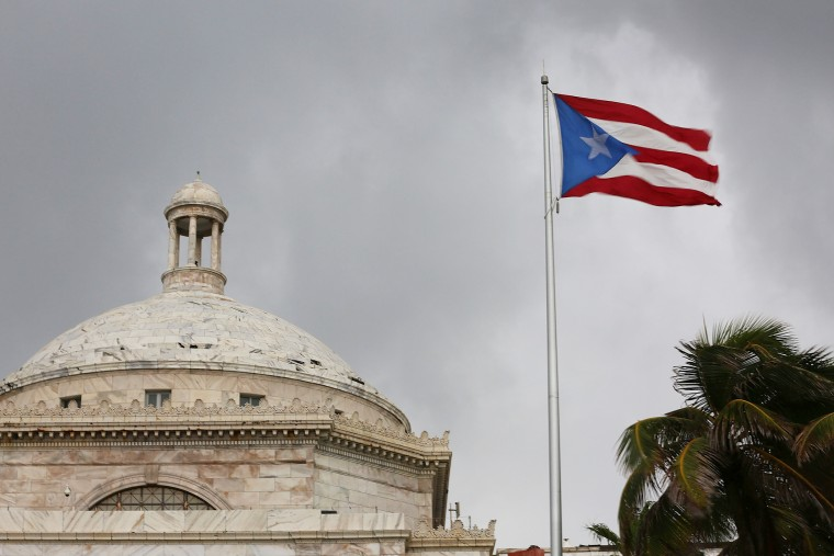 The Puerto Rican flag flies near the Capitol building as the island's residents deal with the government's $72 billion debt on July 1, 2015 in San Juan, Puerto Rico. (Photo by Joe Raedle/Getty)