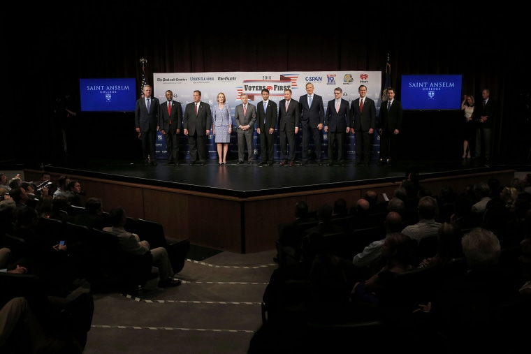 Eleven of the declared 2016 Republican U.S. presidential candidates pose together on stage before the start of the the Voters First Presidential Forum in Manchester (Photo by Brian Snyder/Reuters)