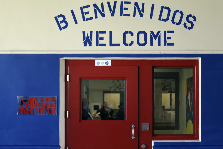 A Spanish and English welcome sign is seen above a door in a secured entrance area at the Karnes County Residential Center in Karnes City, Texas on Jul. 31, 2014.