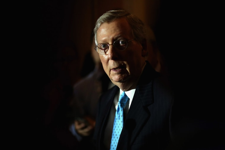 Senate Majority Leader Mitch McConnell (R-KY) talks with reporters reporters after the weekly Senate Republican policy luncheon at the U.S. Capitol Aug. 4, 2015 in Washington, D.C. (Photo by Chip Somodevilla/Getty)