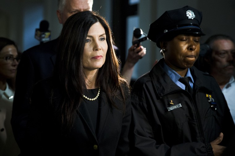 Pennsylvania Attorney General Kathleen Kane walks from the State Supreme Court room on Mar. 11, 2015, at City Hall in Philadelphia (Photo by Matt Rourke/AP).