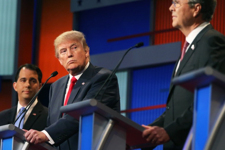 Republican presidential candidate Donald Trump looks toward Jeb Bush, right, as Scott Walker watches during the first Republican presidential debate at the Quicken Loans Arena on Aug. 6, 2015, in Cleveland, Ohio. (Photo by Andrew Harnik/AP)