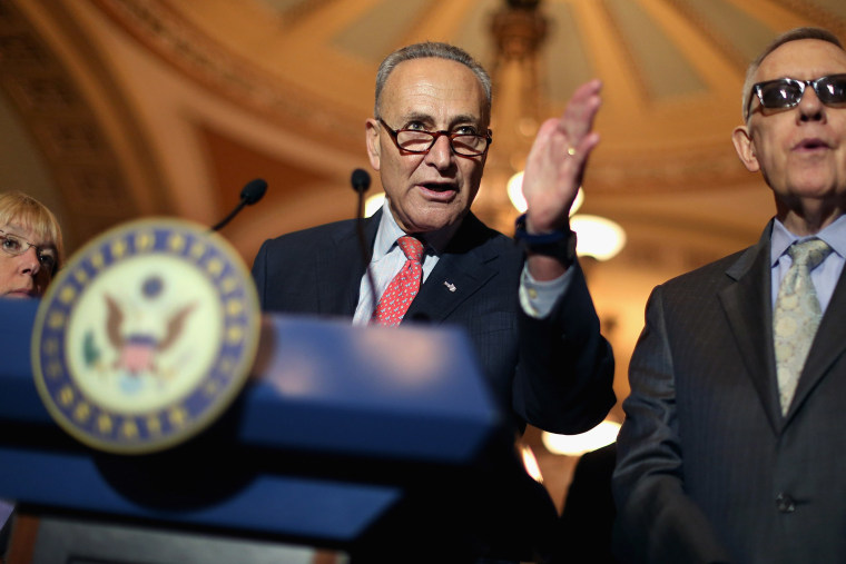 Sen. Charles Schumer and Senate Minority Leader Harry Reid talk with reporters after the weekly Democratic policy luncheon at the U.S. Capitol on Aug. 4, 2015 in Washington, DC. (Photo by Chip Somodevilla/Getty)