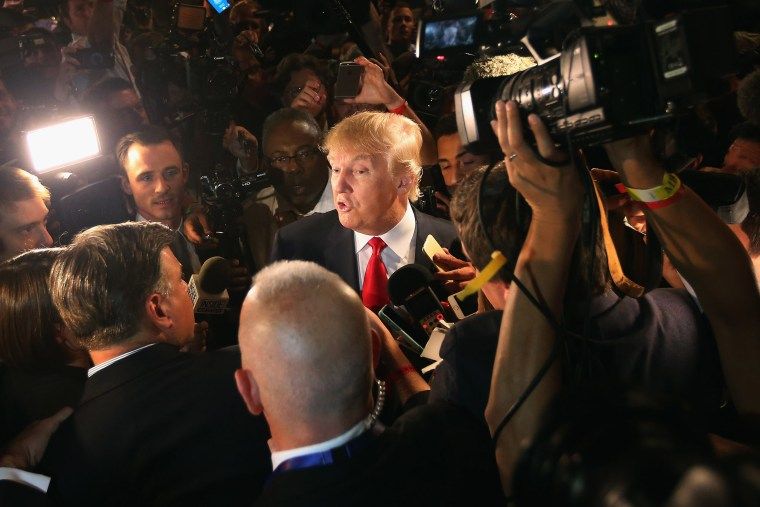 Republican presidential candidate Donald Trump talks to reporters in the 'Spin Alley' after the first prime-time presidential debate hosted by FOX News and Facebook at the Quicken Loans Arena on Aug. 6, 2015 in Cleveland, Ohio. (Photo by Scott Olson/Getty