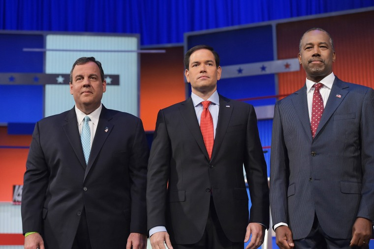 New Jersey Gov. Chris Christie, Florida Sen. Marco Rubio, and retired neurosurgeon Ben Carson participate in the Republican presidential primary debate on Aug. 6, 2015 at the Quicken Loans Arena in Cleveland, Ohio. (Photo by Mandel Ngan/AFP/Getty)