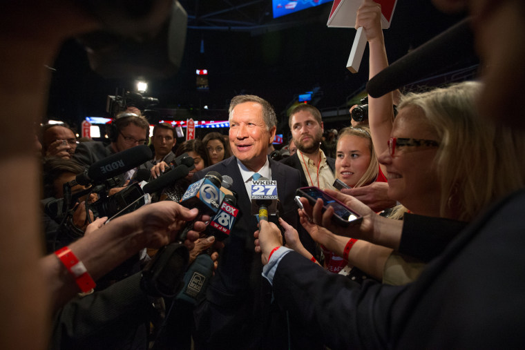 Republican presidential candidate Ohio Gov. John Kasich speaks to members of the media in the spin room following the first Republican presidential debate at the Quicken Loans Arena, Aug. 6, 2015, in Cleveland. (Photo by Andrew Harnik/AP)