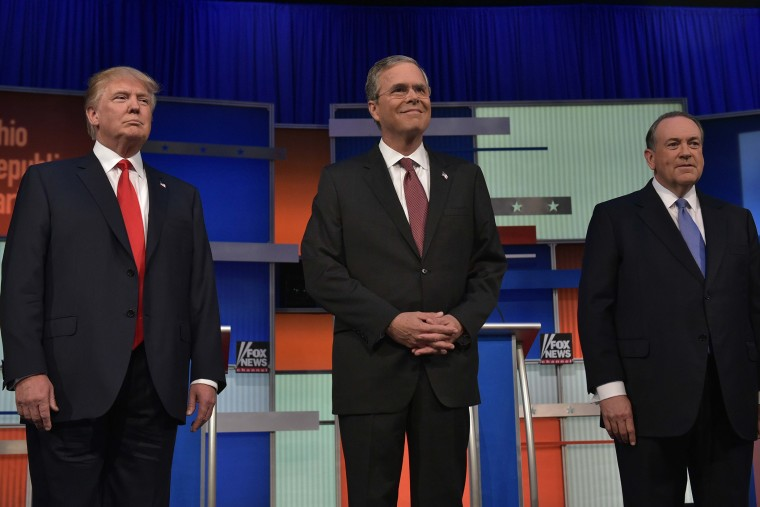 Real estate tycoon Donald Trump, former Florida governor Jeb Bush, and former Arkansas governor Mike Huckabee at Republican debate Aug. 6, 2015. (Photo by Mandel Ngan/ AFP/Getty)