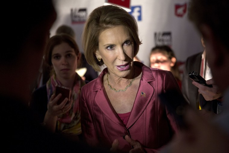 Carly Fiorina, 2016 Republican presidential candidate, speaks to the media in the spin area after a televised forum ahead of the first Republican presidential debate (Photo by Andrew Harrer/Bloomberg/Getty).
