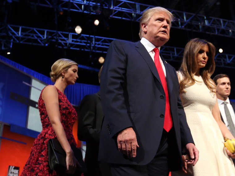 Republican presidential candidate Donald Trump leaves the stage with his wife Melania Trump and his daughter, Ivanka Trump. after the first Republican presidential debate, Aug. 6, 2015, in Cleveland. (Photo by Andrew Harnik/AP)