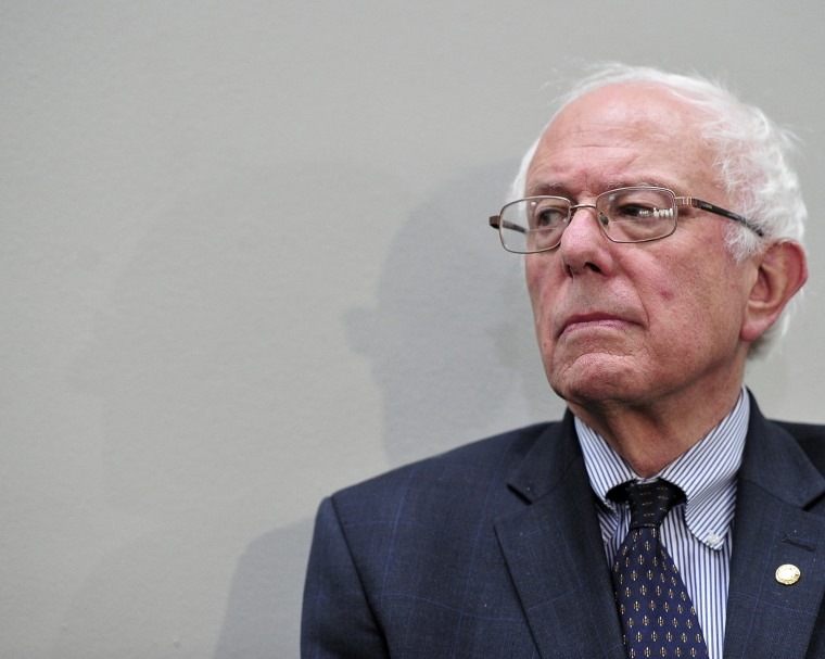 U.S. Sen. and presidential candidate Bernie Sanders listens to one of the speakers after making remarks at the Conference on the Greek debt crisis in Washington, DC, July 30, 2015. (Photo by Ron Sachs/picture-alliance/dpa/AP)