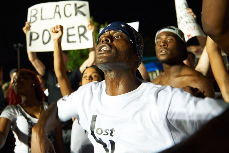 Demonstrators protest during a march on Aug. 8, 2015 at the Ferguson Police Department in Ferguson, Mo. (Photo by Michael B. Thomas/AFP/Getty)