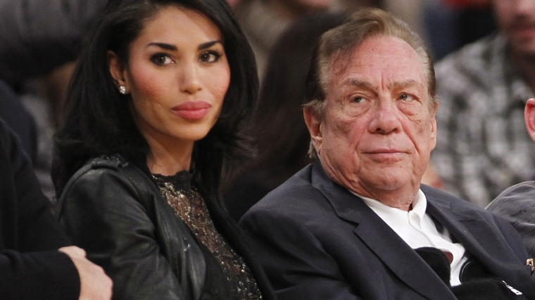Los Angeles Clippers owner Donald Sterling, right, and V. Stiviano. (Photo by Danny Moloshok/AP)