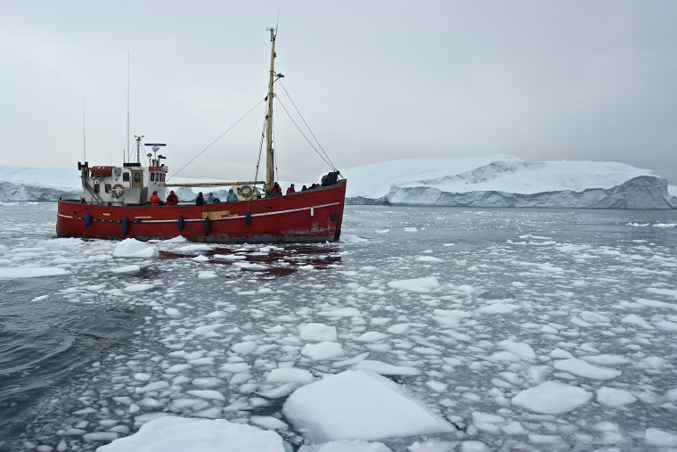 Ship among icebergs in Greenland. (Photo by DeAgostini/Getty)