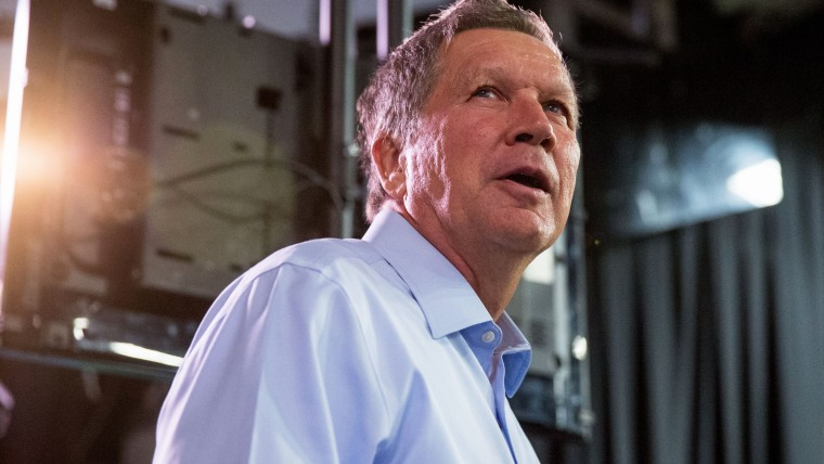 Republican presidential candidate, Ohio Gov. John Kasich, center, greets members of the media at Quicken Loans Arena in Cleveland, Ohio on Aug. 6, 2015. (Photo by Andrew Harnik/AP)
