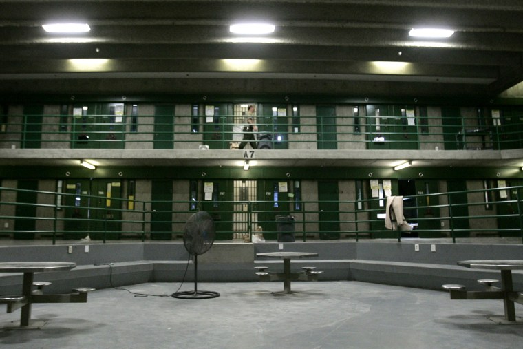 Correctional Officer Max Nelson makes the rounds, every 30 minutes, checking on inmates in the segregation unit for suicide attempts, at California State Prison, Sacramento, in Folsom, Calif., March 30, 2007. (Photo by Rich Pedroncelli/AP)