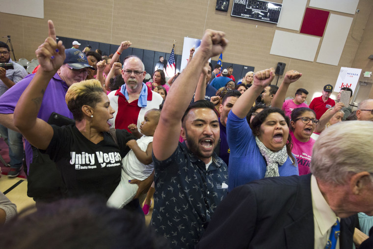 """Activists including A.J. Buhay, center, chant \""""Black lives matter\"""" at the end of Republican presidential candidate Jeb Bush's town hall meeting at the Pearson Community Center in North Las Vegas, Nev., Aug. 12, 2015. (Steve Marcus/Las Vegas Sun/AP)"""