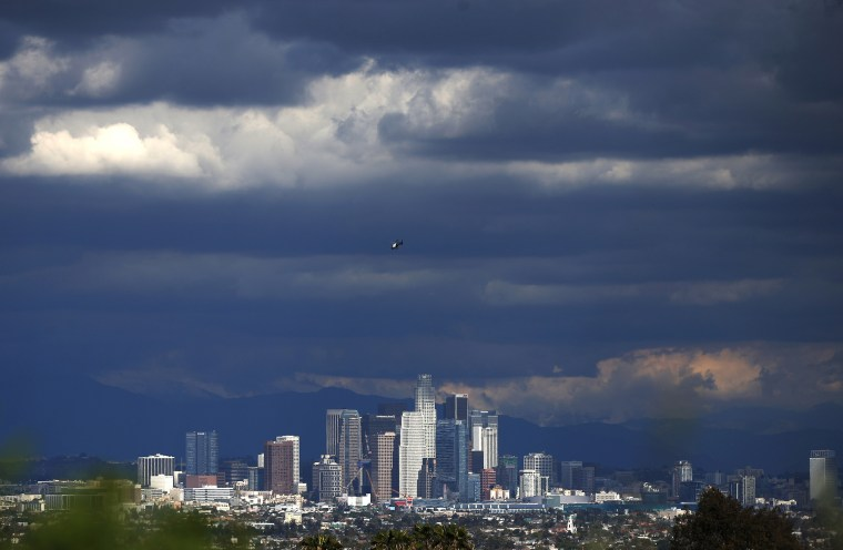 Rain clouds move in over downtown Los Angeles, Calif., March 2, 2015. (Photo by Lucy Nicholson/Reuters)