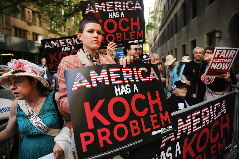Activists hold a protest near the Manhattan apartment of billionaire and Republican financier David Koch on June 5, 2014 in New York City. (Photo by Spencer Platt/Getty)