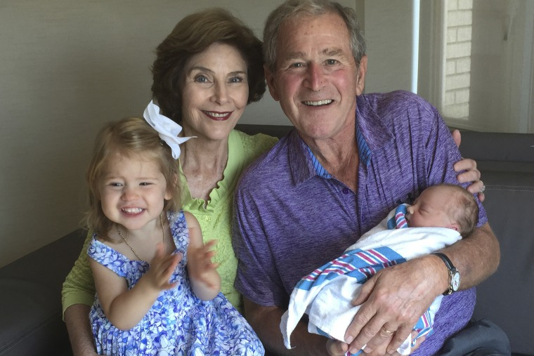 Former U.S. President George W. Bush and his wife Laura pose with their grand daughters Poppy Louise and Mila in New York. (Photo by Handout . / Reuters)