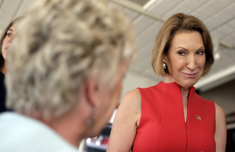 Republican presidential candidate Carly Fiorina talks to restaurant patron during a campaign stop at the Starboard Market, Aug. 14, 2015, in Clear Lake, Ia. (Photo by Charlie Riedel/AP)