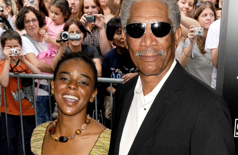"""Actor Morgan Freeman and goddaughter E'Dena Hines arrive at """"The Dark Knight"""" premiere at the AMC Loews Lincoln Square theater on July 14, 2008 in New York City. (Photo by Gregg DeGuire/WireImage/Getty)"""