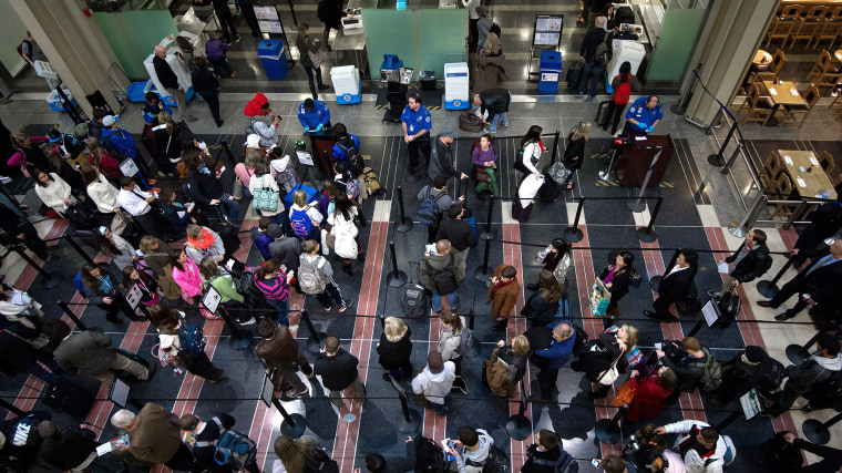 Holiday travelers line up for one of the TSA security checkpoints at Ronald Reagan National Airport (DCA) in Washington on November 26, 2013. (Photo by Paul J. Richards/AFP/Getty)