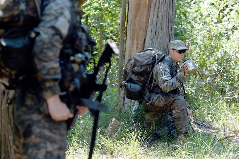 A female Ranger student holds a position with her team during an exercise on Aug. 4, 2015, at Camp James E. Rudder on Eglin Air Force Base, Fla. (Photo by Nick Tomecek/Northwest Florida Daily News/AP)