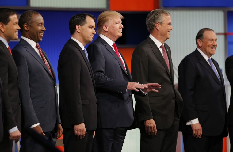 Republican 2016 presidential candidates pose at the start of the first official Republican presidential candidates debate of the 2016 U.S. presidential campaign in Cleveland