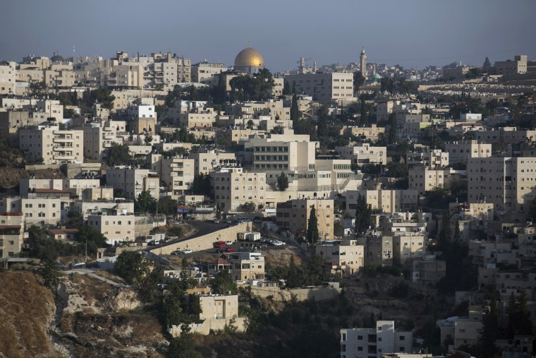 The Arab East Jerusalem neighbourhood of Ras al-Amud is seen in front of the Dome of the Rock