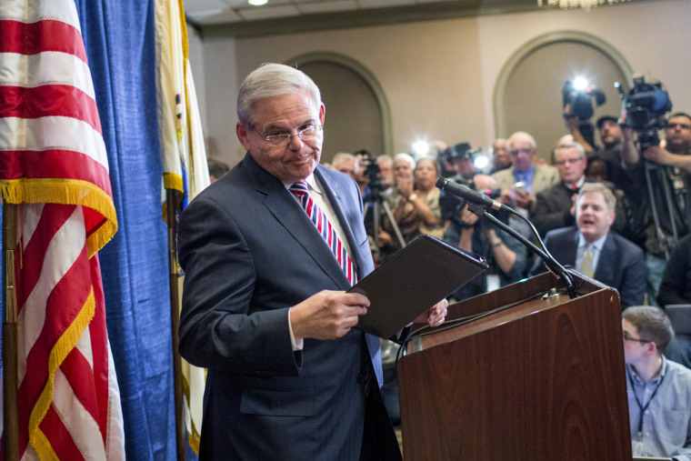 Senator Menendez exits the podium after speaking to the media during a news conference in Newark