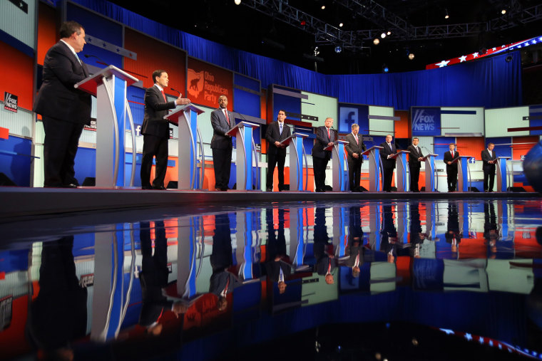Republican presidential candidates take the stage for the first Republican presidential debate at the Quicken Loans Arena, Aug. 6, 2015, in Cleveland. (Photo by Andrew Harnik/AP)