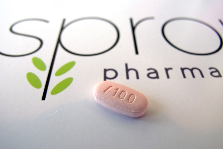 In this June 22, 2015, photo, a tablet of flibanserin sits on a brochure for Sprout Pharmaceuticals in the company's Raleigh, N.C., headquarters. (Photo by Allen G. Breed/AP)