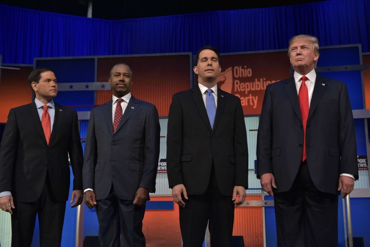 Florida Senator Marco Rubio, retired neurosurgeon Ben Carson, Wisconsin Gov. Scott Walker, and real estate magnate Donald Trump return to the stage following a break in the Republican presidential primary debate on August 6, 2015 at the Quicken Loans Aren