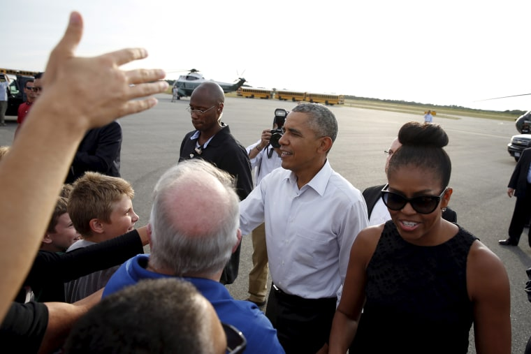 U.S. President Barack Obama and first lady Michelle Obama greet well wishers upon their arrival in Martha's Vineyard