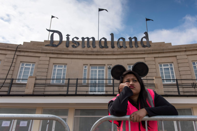A steward is seen outside Bansky's 'Dismaland' exhibition at a derelict seafront lido on Aug. 20, 2015 in Weston-Super-Mare, England. (Photo by Matthew Horwood/Getty)