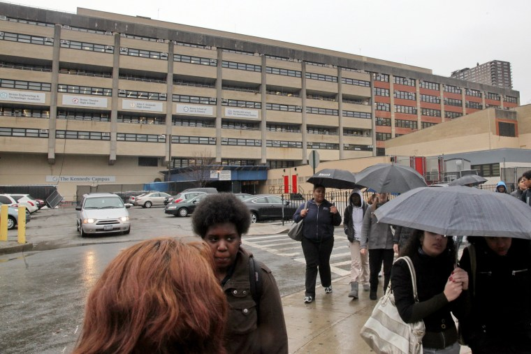 Students leave the John F. Kennedy multi-high school campus during afternoon showers in the Bronx, N.Y. on March 12, 2010. (Photo by Bebeto Matthews/AP)