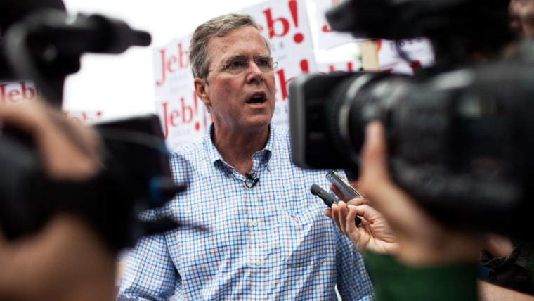 Republican Presidential candidate Jeb Bush speaks to the press at the 4th of July Parade in Merrimack, N.H. (Photo by Kayana Szymczak/Getty)