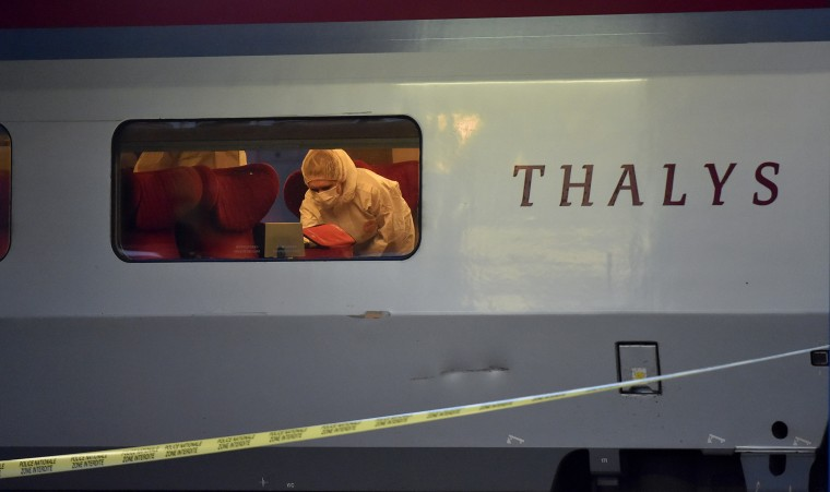 Police inspect the crime scene inside a Thalys train of French national railway operator SNCF at the main train station in Arras, northern France, on Aug. 21, 2015. (Photo by Philippe Huguen/AFP/Getty)