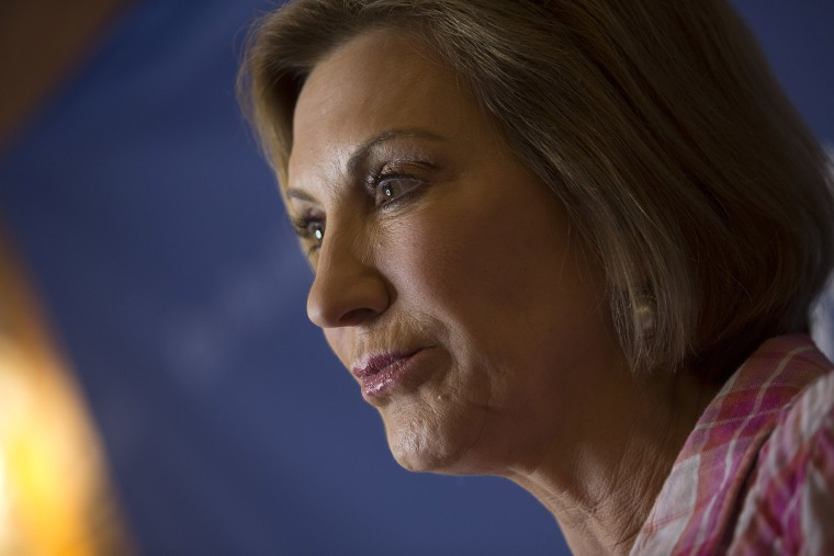 Carly Fiorina, 2016 Republican presidential candidate, listens to a question during an interview after speaking to attendees at the Iowa State Fair Soapbox in Des Moines, Ia., Aug. 17, 2015. (Photo by Andrew Harrer/Bloomberg/Getty)