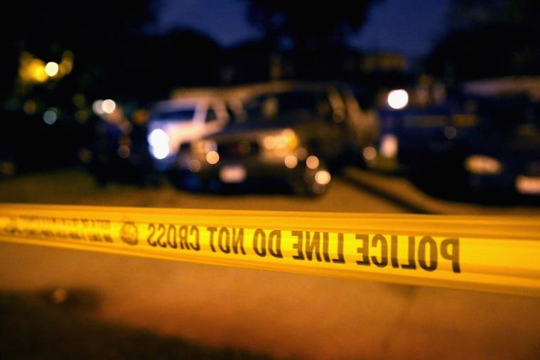 Police tape. (Photo by Scott Olson/Getty)