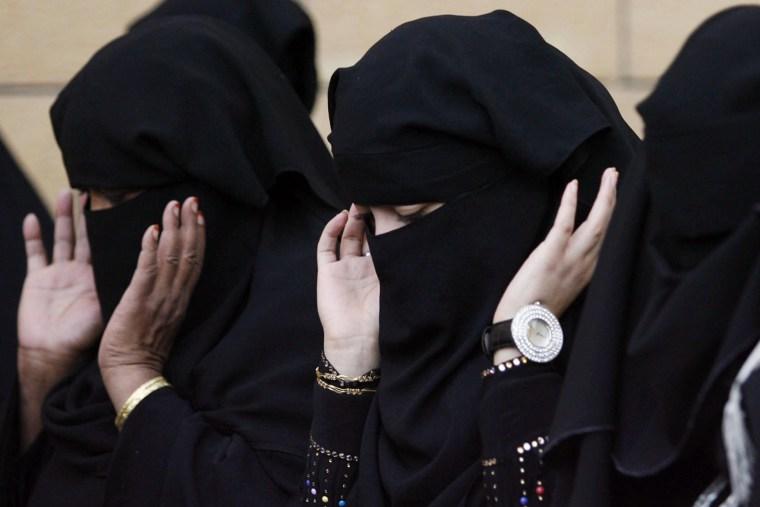 Saudi women pray during Eid al-Adha celebrations on a street in Riyadh, Nov. 27, 2009. (Photo by Stringer/Reuters)