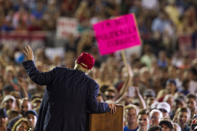 "A Donald Trump supporter's sign reads ""I'm Not Politically Correct"" as the Republican presidential candidate speaks during a rally on August 21, 2015 in Mobile, Alabama. (Photo by Mark Wallheiser/Getty)"
