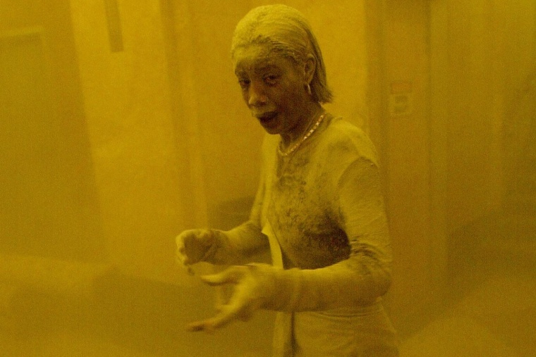 This Sept. 11, 2001 file photo shows Marcy Borders covered in dust as she takes refuge in an office building after one of the World Trade Center towers collapsed in New York. (Photo by Stan Honda/AFP/Getty)