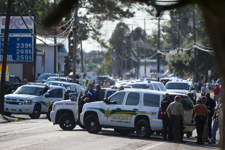 Police gather at the scene of a shooting in Sunset, La. on Aug. 26, 2015. (Photo by Paul Kieu/The Daily Advertiser/AP)
