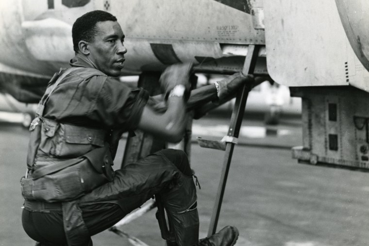Lieutenant Colonel Frank E. Petersen, Jr. climbs into his phantom jet for a combat mission in Vietnam in 1968. (Photo by SSgt Stacy/Marine Corps)