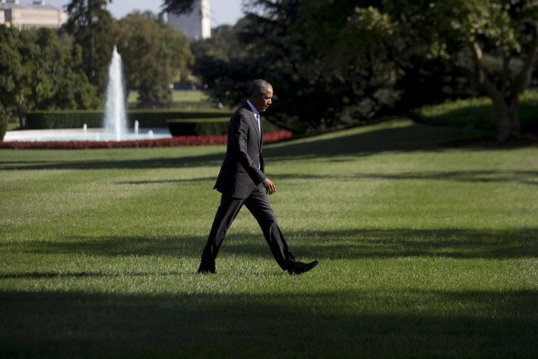 President Barack Obama walks toward the White House after landing on the South Lawn on Aug. 25 in Washington, D.C. (Photo by Andrew Harrer/Pool/Getty)