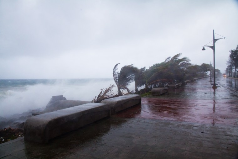 Strong winds and waves batter the coast as tropical storm Erika approaches Santo Domingo, Dominican Republic, Aug. 28, 2015. (Photo by Tatiana Fernandez/AP)