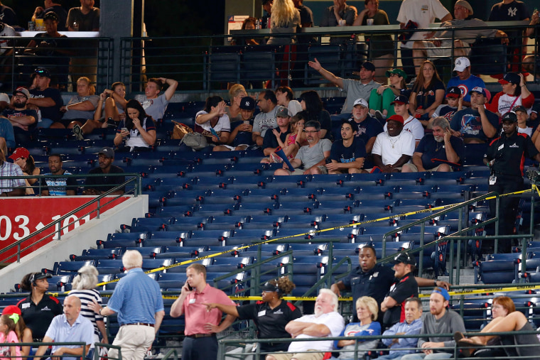 Police block off a section with police tape after a fan fell from the upper deck of Turner Field in the seventh inning during the game between the Atlanta Braves and the New York Yankees on Aug. 29, 2015 in Atlanta, Ga. (Photo by Mike Zarrilli/Getty)