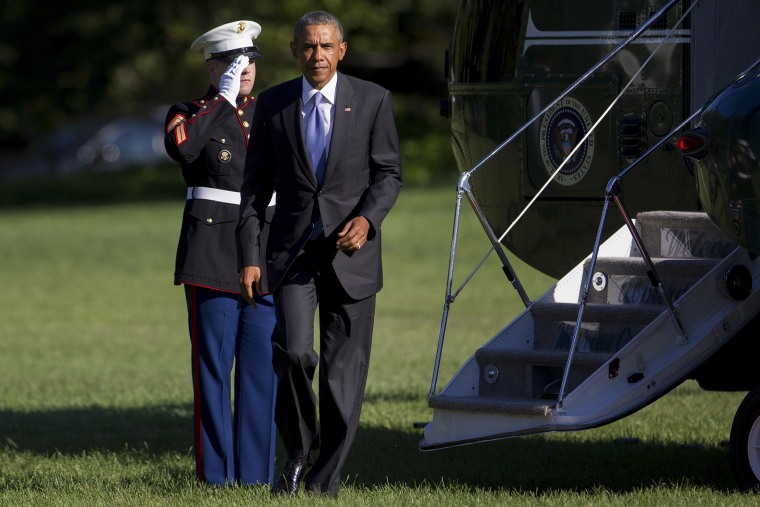 President Barack Obama walks off of Marine One after landing on the South Lawn of the White House on Aug. 25 in Washington, DC. (Photo by Andrew Harrer/Pool/Getty)