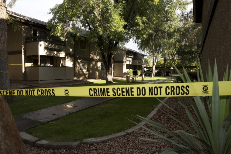 Crime scene tape surrounds buildings at the Autumn Ridge apartment complex which had been searched by investigators in Phoenix, Ariz., May 4, 2015. (Photo by Nancy Wiechec/Reuters)
